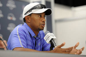 Photo - Tiger Woods speaks at a press conference at the AT&T National Golf tournament, Wednesday, July 26, 2013, in Bethesda, Md. Woods will not play in the tournament. (AP Photo/Nick Wass)