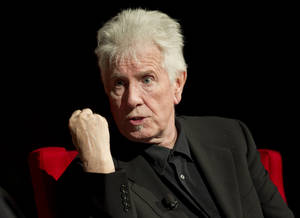 Photo - FILE - In this April 8, 2014 file photo, Rock and Roll Hall of Fame singer-songwriter Graham Nash speaks during the Civil Rights Summit at the Lyndon B. Johnson Presidential Library,  in Austin, Texas. The 72-year-old member of Crosby, Stills and Nash spoke exclusively to The Associated Press on Monday, July 7, 2014, after the Paley Center for Media hosted a discussion with the trio regarding their newly released remastered box set commemorating their 1974 tour with Neil Young. (AP Photo/Statesman.com, Jay Janner, Pool, File)