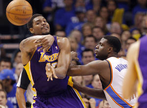 Photo - Los Angeles' Andrew Bynum passes the ball away from Oklahoma City's Nazr Mohammed during Game 2 in the second round of the NBA playoffs between the Oklahoma City Thunder and the L.A. Lakers at Chesapeake Energy Arena on Wednesday,  May 16, 2012, in Oklahoma City, Oklahoma. Photo by Chris Landsberger, The Oklahoman