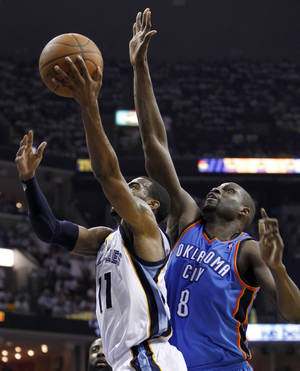 Photo - Memphis Grizzlies guard Mike Conley (11) drives to the basket ahead of Oklahoma City Thunder center Nazr Mohammed (8) during the first half of Game 4 of a second-round NBA basketball playoff series on Monday, May 9, 2011, in Memphis, Tenn. (AP Photo/Wade Payne)