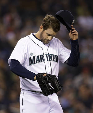 Photo - Seattle Mariners starting pitcher James Paxton turns away from the plate after giving up a two-run home run to Los Angeles Angels' Albert Pujols in the first inning Tuesday, April 8, 2014, in Seattle. (AP Photo/Elaine Thompson)