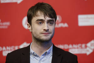 "Photo - File - Actor Daniel Radcliffe poses at the premiere of ""Kill Your Darlings"" during the 2013 Sundance Film Festival on Friday, Jan. 18, 2013 in Park City, Utah. Radcliffe has really left Harry Potter behind with a startling and explicit Sundance Film Festival role as poet Allen Ginsberg that puts Radcliffe into daring territory. (Photo by Danny Moloshok/Invision/AP, file)"