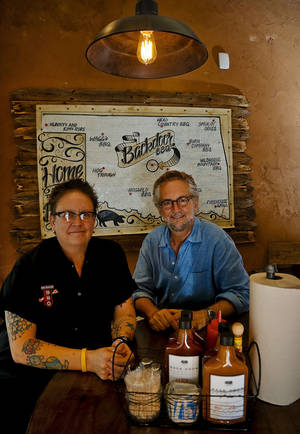 Photo - Chef and co-partner Kathryn Mathis with co-partner Chris Lower pose for a photo at the new Back Door Barbecue at 315 NW 23 in Oklahoma City. Photo by Chris Landsberger, The Oklahoman <strong>CHRIS LANDSBERGER - CHRIS LANDSBERGER</strong>