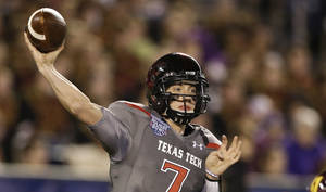 Photo - Texas Tech quarterback Davis Webb throws a pass during his record setting first half against Arizona State during  the Holiday Bowl NCAA college football football game Monday, Dec. 30, 2013, in San Diego. Webb threw four touchdown passes and 301 yards in the first half. (AP Photo/Gregory Bull)