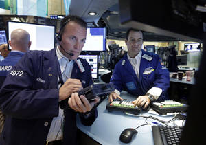 Photo - Trader Jonathan Corpina, left, and specialist Michael McDonnell work on the floor of the New York Stock Exchange Friday, Aug. 16, 2013. Stocks bounced back Friday from consecutive days of significant declines, with more evidence of a rebounding U.S. housing market.(AP Photo/Richard Drew)