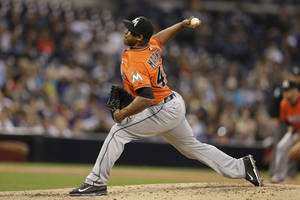 Photo - Miami Marlins relief pitcher Carlos Marmol throws against the San Diego Padres during the sixth inning of a baseball game Saturday, May 10, 2014, in San Diego. (AP Photo/Gregory Bull)