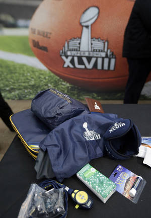 Photo - Cold weather gear, which will be given to people attending Super Bowl Super Bowl XLVII, are on display during a news conference at MetLife Stadium, Wednesday, Jan. 22, 2014, in East Rutherford, N.J. Super Bowl XLVIII, which will be played between the Denver Broncos and the Seattle Seahawks on Feb. 2, will be the first NFL title game held outdoors in a city where it snows. (AP Photo/Julio Cortez)