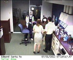 Photo - This image from a security camera shows a teller line at IBC Bank, 421 S Santa Fe in Edmond. PHOTO PROVIDED