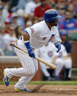 Photo - Chicago Cubs' Emilio Bonifacio runs to first on a bunt-single against the St. Louis Cardinals during the fourth inning of a baseball game on Saturday, July 26, 2014, in Chicago. (AP Photo/Andrew A. Nelles)
