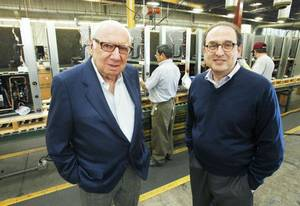 photo - Jack Golsen, CEO (left) and Barry Golsen, Chairman of LSB Industries, stand in front of one of the assembly lines at ClimateMaster in Oklahoma City, OK, Monday, Oct. 17, 2011. By Paul Hellstern, The Oklahoman ORG XMIT: KOD