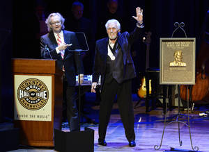 "Photo - Country music star Kenny Rogers thanks the audience at the ceremony for the 2013 inductions into the Country Music Hall of Fame on Sunday, Oct. 27, 2013, in Nashville, Tenn. The inductees are Bobby Bare, the late ""Cowboy"" Jack Clement and Kenny Rogers. (AP Photo/Mark Zaleski)"