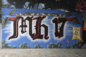 "Photo - Graffiti under a railway bridge commemorates the victims of Malaysia Airlines Flight 17 in The Hague, Netherlands, Thursday, July 24, 2014. Dutch Prime Minister Mark Rutte says he is sending 40 unarmed military police to eastern Ukraine as part of a ramped-up effort to find the last victims of the downing of Malaysia Airlines Flight 17 still at the crash site. Rutte told The Associated Press he is sending the police not as security for the site in rebel-held territory but as ""extra hands and eyes to look for remaining remains and personal belongings"" of victims. (AP Photo/Mike Corder)"
