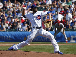 Photo - Chicago Cubs starting pitcher Jake Arrieta delivers during the first inning of a baseball game against the St. Louis Cardinals, Friday, Aug. 16, 2013, in Chicago. (AP Photo/Charles Rex Arbogast)