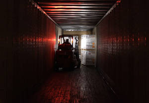photo - In this Friday, Nov. 16, 2012, photo, an employee works at a shipping area of Generac Power Systems, Inc., one of the largest makers of residential generators in the U.S., in Whitewater, Wis.  A survey shows U.S. manufacturing shrank in November to its weakest level since July 2009, the first month after the Great Recession ended. Worries about automatic tax increases in the New Year cut demand for factory orders and manufacturing jobs. (AP Photo/Nam Y. Huh)