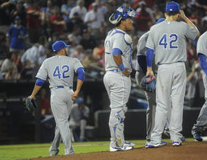 Photo - Kansas City Royals relief pitcher Kelvin Herrera, left, is relieved after allowing consecutive runs by the Atlanta Braves during the eighth inning of a baseball game, Tuesday, April 16, 2013, in Atlanta. (AP Photo/John Amis)