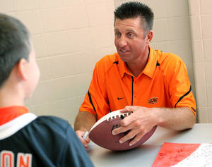 photo - OSU coach Mike Gundy is approved of by 75 percent of Cowboy fans polled by The Oklahoman. PHOTO BY JOHN CLANTON, THE OKLAHOMAN