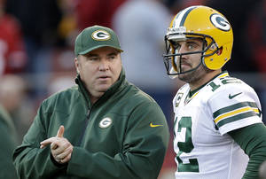Photo - FILE - In this Jan. 12, 2013 file photo, Green Bay Packers head coach Mike McCarthy talks with quarterback Aaron Rodgers (12) before an NFC divisional playoff football game against the San Francisco 49ers in San Francisco. (AP Photo/Marcio Jose Sanchez, File)
