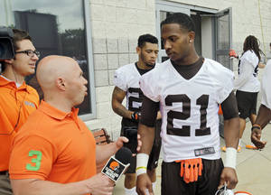 Photo -  Cleveland Browns cornerback Justin Gilbert (21) talks with the team's reporter after a mandatory minicamp practice at the NFL football team's facility in Berea, Ohio, Wednesday, June 11, 2014. The Browns selected Gilbert early in the first round, before quarterback Johnny Manziel, hoping that by putting him on the opposite side of Pro Bowler Joe Haden, back center, they can shut down passing games. (AP Photo/Mark Duncan)  <strong>Mark Duncan</strong>