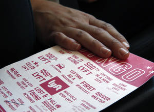 Photo -   A Lyft bingo card is available for riders to play inside a private car driven by a part-time Lyft driver in Denver.  AP Photo  <strong>Brennan Linsley -  AP </strong>