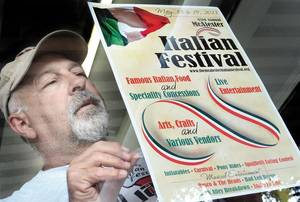 Photo - Bob Lenardo puts up a sign for the Italian Festival, which will be Saturday and Sunday at the Southeast Expo Center. (McAlester News-Capital photo)