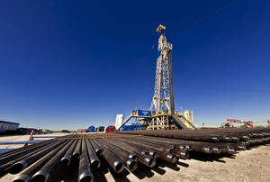Photo - A Devon Energy Corp. drilling rig in the Permian Basin near Midland, Texas. The Oklahoma City company last week invested $6 billion in oil-rich Texas assets. <strong> - PROVIDED</strong>