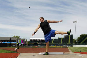photo - Former OU standout Kevin Bookout practices before the U.S. Olympic Track and Field Trials. Bookout missed the Olympics, but worked out for the NFLs New York Jets this week. AP Photo