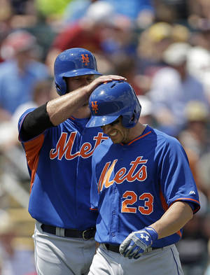 Photo - New York Mets' Taylor Teagarden (23) is congratulated at the plate by Kirk Nieuwenhuis after his two-run homer in the first inning of a exhibition baseball game against the Minnesota Twins in Fort Myers, Fla., Friday, March 21, 2014. (AP Photo/Gerald Herbert)