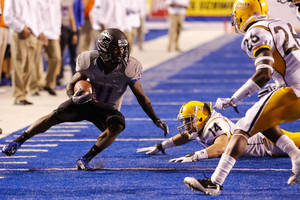 Photo - CORRECTS DAY OF WEEK - Boise State wide receiver Shane Williams-Rhodes (11) runs the ball past Southern Mississippi linebacker Terrick Wright (14) during the first half of an NCAA college football game in Boise, Idaho, Saturday, Sept. 28, 2013. (AP Photo/Otto Kitsinger)