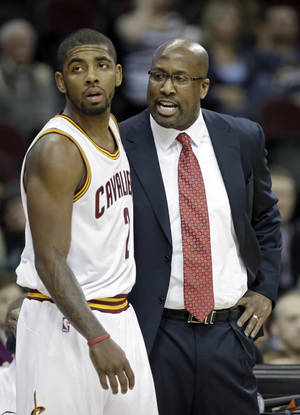 Photo - Cleveland Cavaliers head coach Mike Brown, right, talks to Kyrie Irving in the first quarter of an NBA basketball game against the Los Angeles Lakers, Wednesday, Feb. 5, 2014, in Cleveland. (AP Photo/Mark Duncan)