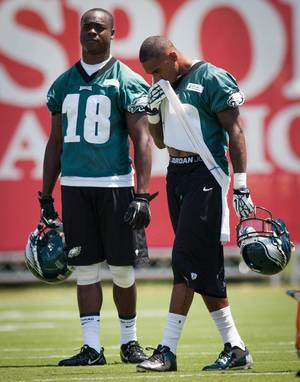 Photo - Philadelphia Eagles wide receiver DeSean Jackson, right, and Jeremy Maclin take a break between drills at NFL football training camp in Philadelphia, Friday, July 26, 2013. (AP Photo/The News Journal, Suchat Pederson)  NO SALES