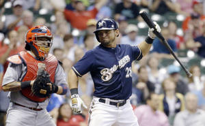 Photo - St. Louis Cardinals catcher Yadier Molina watches as Milwaukee Brewers' Gerardo Parra reacts after Parra struck out during the ninth inning of a baseball game Thursday, Sept. 4, 2014, in Milwaukee. The Cardinals won 3-2. (AP Photo/Morry Gash)