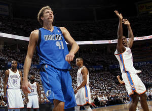 Photo - Dallas' Dirk Nowitzki (41) reacts after making a shot and being fouled by Oklahoma City's Serge Ibaka (9), right, during Game 2 of the first round in the NBA basketball  playoffs between the Oklahoma City Thunder and the Dallas Mavericks at Chesapeake Energy Arena in Oklahoma City, Monday, April 30, 2012. From left in the background are Kevin Durant (35), James Harden (13) and Russell Westbrook (0). Photo by Nate Billings, The Oklahoman