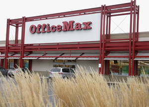 Photo - FILE - This Nov. 1, 2013 file photo shows the exterior of an Office Max store in Chicago. Office Depot is planning to close at least 400 U.S. stores, as its merger with OfficeMax resulted in an overlap of retail locations that can be consolidated. The office supply retailer had 1,900 stores in the U.S. at the end of the first quarter, so the plans call for closing about 21 percent of them. Office Depot and OfficeMax Inc. completed their $1.2 billion deal last November. (AP Photo/Charles Rex Arbogast, File)