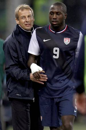 "Photo -   FILE - In this Feb. 29, 2012, file photo, United States forward Jozy Altidore (9) is congratulated by head coach Jurgen Klinsmann as he leaves the field during a friendly soccer match against Italy in Genoa, Italy. Altidore was dropped Monday, Oct. 8, from the U.S. roster for critical World Cup qualifiers. Klinsmann was critical in an espn.com interview published Sept. 28, saying, ""I think Jozy can do a lot better, and he knows that."" (AP Photo/Luca Bruno, File)"