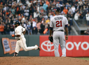 Photo - San Francisco Giants' Pablo Sandoval rounds the bases after his solo home run off Minnesota Twins starting pitcher Samuel Deduno (21) during the second inning in the second inning of a baseball game Saturday, May 24, 2014, in San Francisco. (AP Photo/Tony Avelar)
