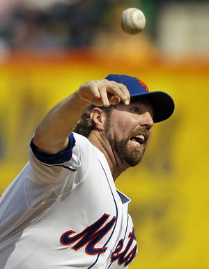 photo - FILE - In this Sept. 27, 2012, file photo, New York Mets starting pitcher R.A. Dickey delivers against the Pittsburgh Pirates during the first inning of a baseball game at Citi Field in New York. Dickey and Mets general manager Sandy Alderson can agree on one thing _ they would prefer to have closure before opening day.  The Cy Young Award winner can become a free agent after the 2013 season and says he won&#039;t negotiate once it starts, so the Mets probably have to sign him to an extension or trade him to get the best return.  (AP Photo/Kathy Willens, File)