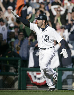 Photo -   Detroit Tigers' Alex Avila celebrates his two-run walk-off home run that gave the Tigers a 13-12 win over the Boston Red Sox in the 11th inning of a baseball game Sunday, April 8, 2012, in Detroit. (AP Photo/Duane Burleson)
