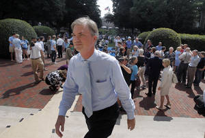 Photo -   FILE - In this Friday, Sept. 21, 2012 file photo, University of North Carolina at Chapel Hill Chancellor Holden Thorp heads back to his office after his remarks at the South Building in Chapel Hill, N.C. Students held a rally trying to persuade the chancellor to remain in his position. Thorp, who announced his resignation earlier in the week said he would not remain in the position beyond the end of the academic calendar year. (AP Photo/The News & Observer, Chuck Liddy, File) MANDATORY CREDIT