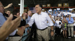 Photo -   Republican presidential candidate Mitt Romney campaigns at PR Machine Works in Mansfield, Ohio, Monday, Sept. 10, 2012. (AP Photo/Charles Dharapak)