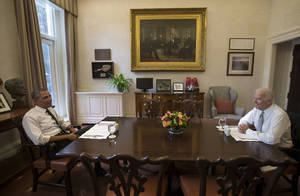Photo - President Barack Obama and Vice President Joe Biden talk during a photo-op as they meet for lunch in the Private Dining Room of the White House in Washington, Wednesday, Jan. 8, 2014. (AP Photo/Carolyn Kaster)
