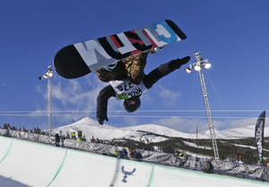 Photo - FILE - In this Dec. 14, 2013, file photo, Taylor Gold competes during the men's snowboarding superpipe final at a Dew Tour event in Breckenridge, Colo. Taylor and Arielle Gold are taking their brother and sister act to Sochi. The Golds are members of the U.S. Olympic halfpipe snowboarding team that is expected to come home from Russia with multiple medals. (AP Photo/Julie Jacobson, File)