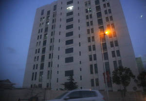 "photo - The building housing ""Unit 61398"" of the People's Liberation Army is seen in the outskirts of Shanghai, Tuesday Feb. 19, 2013. Cyberattacks that stole information from 141 targets in the U.S. and other countries have been traced to the Chinese military unit in the building, a U.S. security firm alleged Tuesday.  According to the report by the Virginia-based Mandiant Corp., it has traced the massive amount of hacking back to the 12-story office building run by ""Unit 61398"", and that the attacks targeted key industries including military contractors and companies that control energy grids. China dismissed the report as ""groundless.""(AP Photo)"