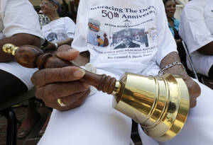 "Photo - Jeanne Smiley of Montgomery, Ala., holds her bell during ceremonies honoring the 50th anniversary of the Martin Luther King Jr., ""I Have a Dream"" speech in Montgomery, Ala., Wednesday, Aug. 28, 2013. The ceremony took place outside the Dexter Ave. King Memorial Baptist Church where King became pastor in 1954. Smiley said ""Rev. King was a great man who helped make this country a better place to live."" (AP Photo/Dave Martin)"