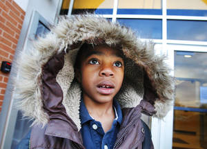 Photo - Kindergarten student D'marion Manuel (CQ D'marion), age 5, arriving at Quail Creek Elementary School bundled against the cold air as students in the Oklahoma City School District return from winter break in Okla. City Friday, Jan. 4, 2013. Photo by Paul B. Southerland, The Oklahoman