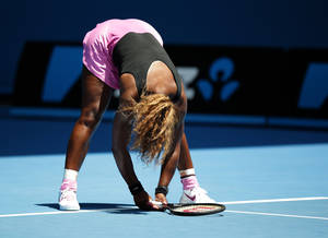 Photo - Serena Williams of the United States reacts after losing a point to Vesna Dolonc of Serbia during their second round match at the Australian Open tennis championship in Melbourne, Australia, Wednesday, Jan. 15, 2014.(AP Photo/Aaron Favila)