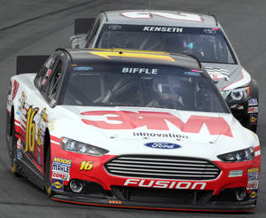 Photo - Greg Biffle leads Matt Kenseth during practice for Sunday's NASCAR Sprint Cup series auto race at New Hampshire Motor Speedway, Saturday, Sept. 21, 2013, in Loudon, N.H. (AP Photo/Jim Cole)