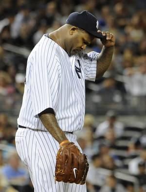 Photo -   New York Yankees starting pitcher CC Sabathia reacts on the mound after Tampa Bay Rays score two runs to take the lead in the fifth inning of a baseball game on Friday, Sept., 14, 2012, at Yankee Stadium in New York. The Rays won 6-4. (AP Photo/Kathy Kmonicek)