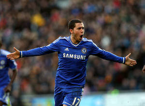 Photo - Chelsea's Eden Hazard celebrates his goal during their English Premier League soccer match against Hull City at the KC Stadium, Hull, England, Saturday, Jan. 11, 2014. (AP Photo/Scott Heppell)
