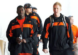 photo -   Oklahoma State's Justin Blackmon, left, and Brandon Weeden walk together as they arrive prior to a Fiesta Bowl NCAA college football game news conference Thursday, Dec. 29, 2011, in Paradise Valley, Ariz. Oklahoma State will face Stanford in the 41st annual Fiesta Bowl on Jan. 2, 2012. (AP Photo/Ross D. Franklin)