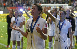 photo - United States&#039; Abby Wambach gestures to the crowd after the US lost the final match between Japan and the United States at the Women World Cup in Germany on Sunday. AP PHOTO